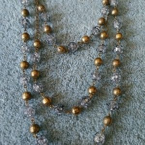 Beaded clear and gold long tri string necklace